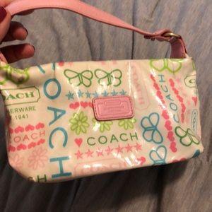 A leather coach small purse